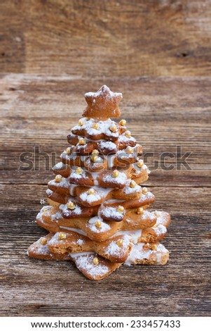 one gingerbread christmas tree on wooden background - stock photo