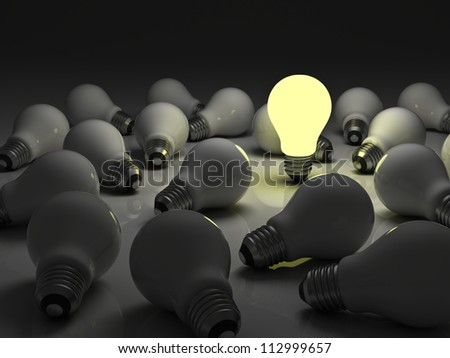 One glowing light bulb standing out from the unlit incandescent bulbs with reflection , The business concept and individuality concept - stock photo
