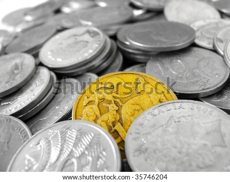 One gold coin among silver coins - stock photo