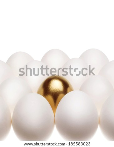 one gold egg lays among common white eggs - stock photo