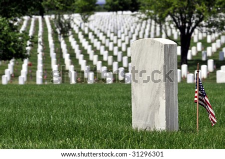 One gravestone with copyspace in front of endless rows of graves at the Arlington National Cemetery in Arlington, Virginia, near Washington DC - stock photo