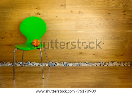 One green Chair and one Orange / empty room / modern interior - stock photo