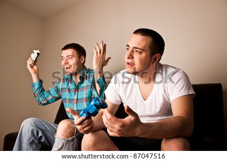 One guy loses to another while playing a video game - stock photo
