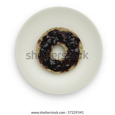 One half of a Whole Grain Bagel with Blueberry Marmalade on a white plate. Isolated on white background. Saved with clipping path. - stock photo