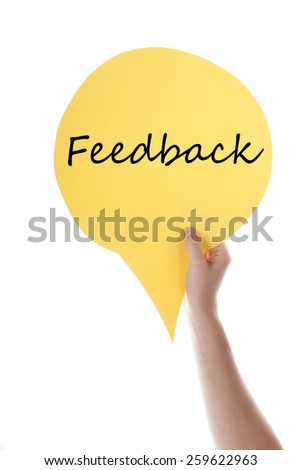 One Hand Holding A Yellow Speech Balloon Or Speech Bubble With English Text Feedback Isolated On White - stock photo