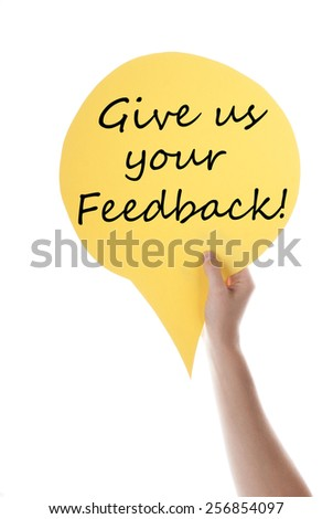 One Hand Holding A Yellow Speech Balloon Or Speech Bubble With English Text Give Us Your Feedback Isolated On White - stock photo