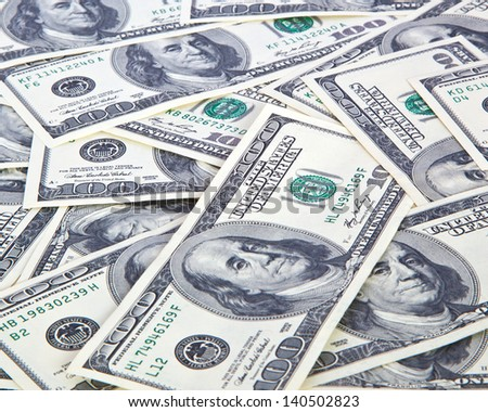 One handred dollar bills background - stock photo