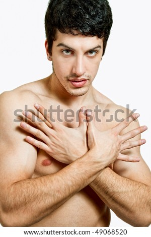 One handsome young man showing his manicure - stock photo