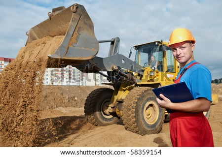 One happy builder worker with clipboard inspecting construction site - stock photo