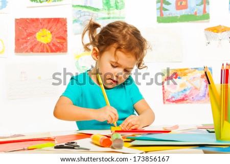 One happy little girl painting on creative class in kindergarten - stock photo