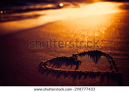 one heart drawn in the sand at the beach - stock photo
