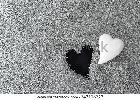 One heart lost, concept for a sympathy card, death of a loved one - stock photo