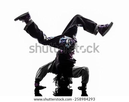 one hip hop breakdancer breakdancing handstand man silhouette white background - stock photo