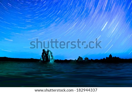 One hour sections of light and star trails over Mono Lake tufas. - stock photo