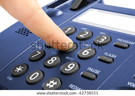 One human hand pressing key on phone - stock photo