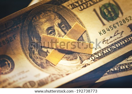One hundred dollar bill and plaster.  - stock photo