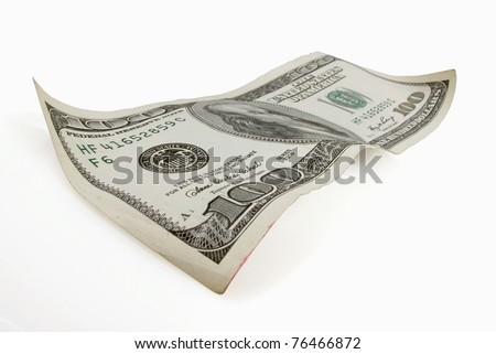 One hundred dollar bill appears to float on white - stock photo