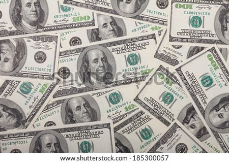 One hundred dollar bills pile background texture - stock photo