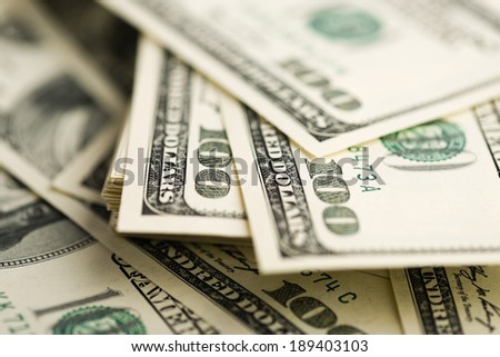 One Hundred Dollar Bills. (shallow DOF)  - stock photo