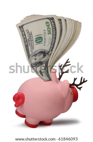 One Hundred Dollar Bills stuffed in the Back of a Reindeer Piggy bank. - stock photo