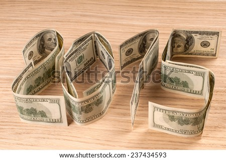 One hundred dollars in shape of 2015. New year concept. - stock photo