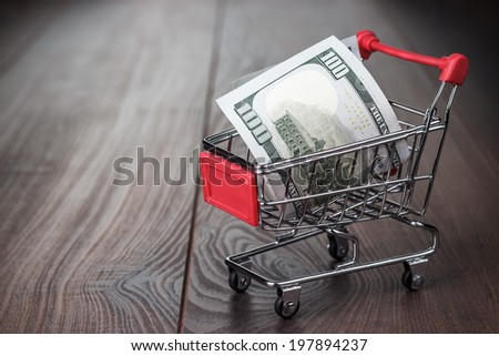 one hundred dollars in the shopping trolley - stock photo