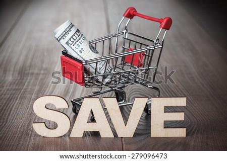 one hundred dollars in the shopping trolley saving concept - stock photo