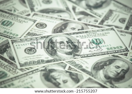 One hundred dollars pile as background. with filter effect - stock photo