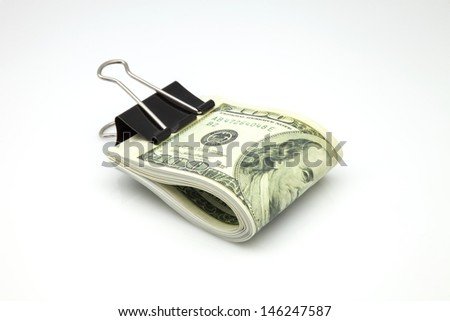 one hundred dollars subjects with a clamp - stock photo