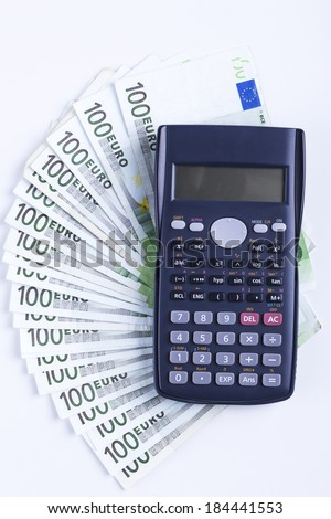 One hundred Euro banknotes with Black calculator isolated on white background - stock photo