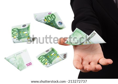 One hundred euro money banknotes flying and falling on young business woman hand, isolated on white background. - stock photo