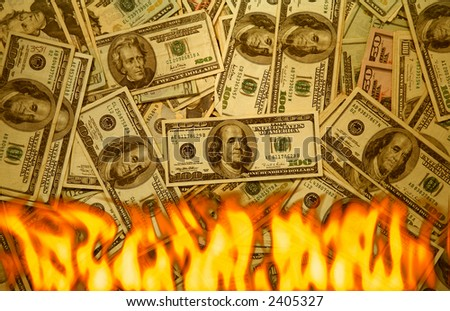 One hundred,fifty and twenty dollar bills on fire - stock photo