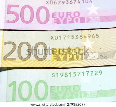 One hundred, two hundred and five hundred euro banknotes close-up. Shallow focus. - stock photo