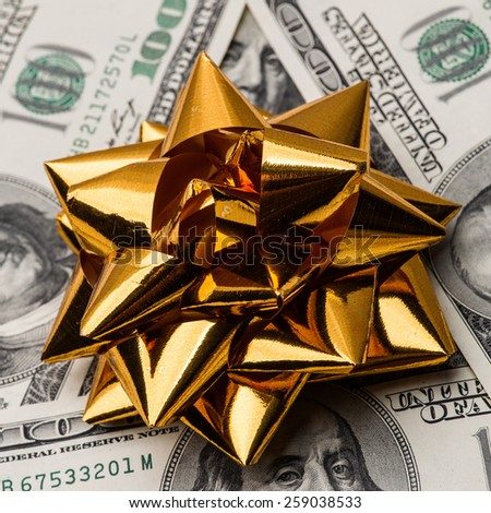 One hundred US dollars bills with holidays bow - stock photo