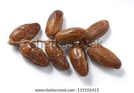One isolated branch of dates on the white background - stock photo