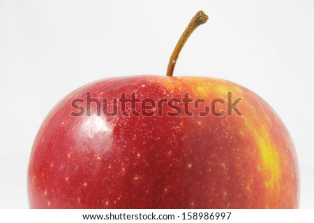 One Juicy Hot Red Apple over a White Background - stock photo