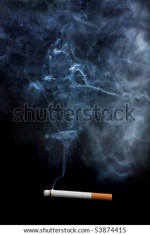 One lighted cigarette and the smoke it creates, over a black background. - stock photo