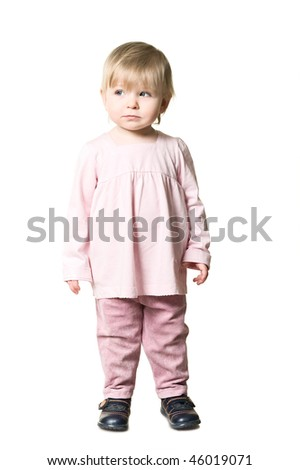 One little girl standing along in pink clothes. Isolated on white background. - stock photo