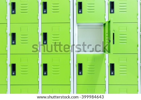 One locker open.Green locker.Green background.Different background concept. - stock photo