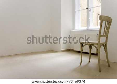 one lonley chair in a apartment which seemed to be abandoned. - stock photo