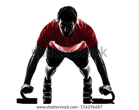 one  man exercising fitness workout push ups  in silhouette  on white background - stock photo