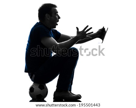 one  man holding digital tablet surprised in silhouette on white background - stock photo