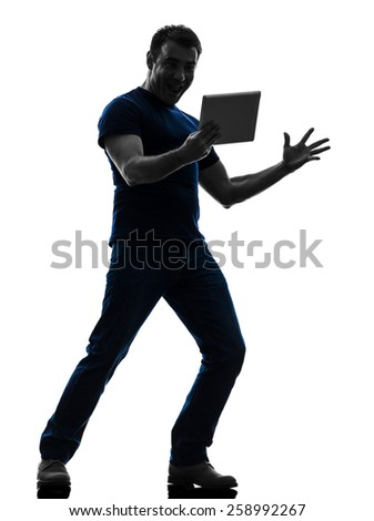 one  man holding watching digital tablet in silhouette on white background - stock photo
