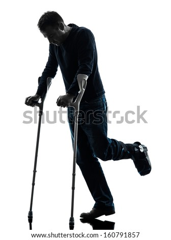 one  man injured man walking with crutches in silhouette studio  on white background - stock photo