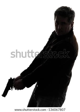 one man killer policeman holding gun silhouette studio white background - stock photo