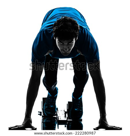 one  man runner sprinter on starting blocks in silhouette studio isolated on white background - stock photo