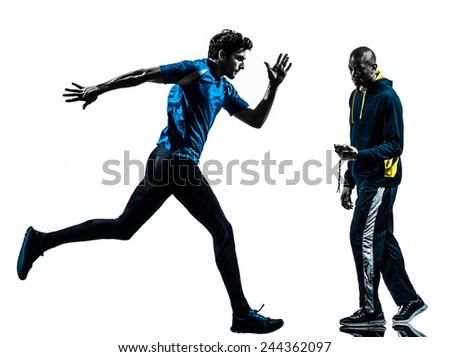one  man running sprinting with coach stopwatch in silhouette studio isolated on white background - stock photo