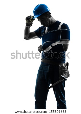 one  manual worker man with injury brace in silhouette on white background - stock photo