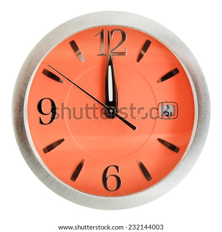 one minute to twelve o'clock on orange dial isolated on white background - stock photo