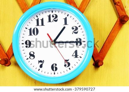 One o'clock on the blue wall clocks - stock photo